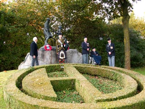 5th Camerons, Derek Suggate, CSM James Petrie, Reginald Leadbeater MM and Richard Massey with Piper Peter Grant of The Highlanders at the Highland Division memorial, Schijndel, Holland. The 65th Anniversary of Liberation.