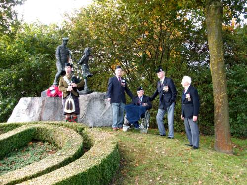 Piper Grant of The Highlanders, plays a lament for ex CSM James Petrie age 89, Reginald Leadbeater MM aged 94, Richard Massey aged 84 and Derek Suggate aged 84 at the Highland Division memorial, Schijndel, Holland, October 2009. The 65th anniversary of Liberation.