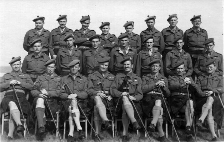 5th Cameron officers 1945, Tony Noble(father of Richard Noble) with dog on lap
