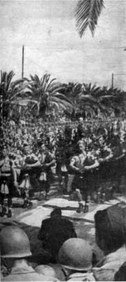 51st Highland Division Pipers lead the victory parade in Tunis