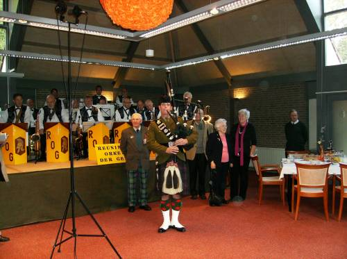 Piper Grant, The Highlanders, 4th battalion the Royal Regiment of Scotland, plays the Highland Division veterans to their lunch at Huize Bergen, Vught.
