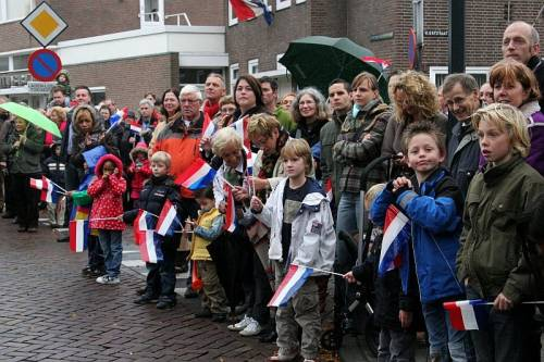 The people of Vught line the streets to greet the 51st Highland Division veterans on their parade of Honour.