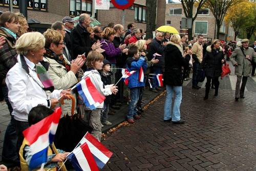 The people of Vught line the streets to greet the 51st Highland Division veterans on their parade of honour