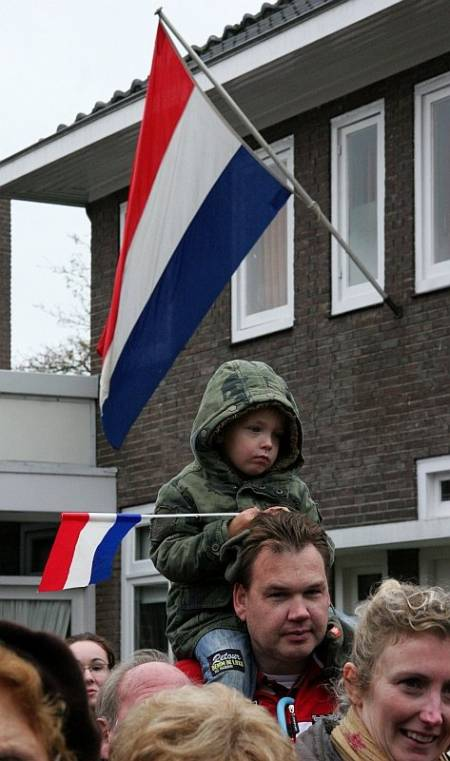 The people of Vught line the streets to applaud and greet the 51st Highland Division veterans on their parade of honour