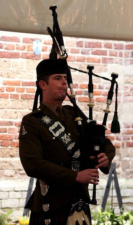 Piper Grant, The Highlanders, 4th battalion the Royal Regiment of Scotland plays the lament 'Flowers of the Forest' at the Lambertus Tower, Vught.