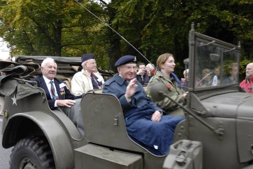 3 veterans of 51st Highland Division, James Duffus,( front seat), Royal Artillery, with Derek Suggate and James Petrie, both 5th battalion Queens Own Cameron Highlanders,( back seat) on the parade of honour, Vught October 2009.