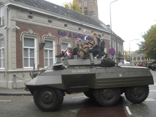 Some of the children of Vught enjoying joining in with the veterans on their parade of honour, Vugh,t Holland. October 2009.