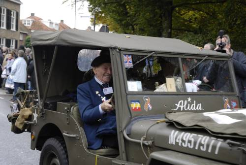 Ronald Titterton, Derbyshire Yeomanry, 51st Highland Division reconnaissance regiment veteran travels in a jeep on the parade of honour, Vught Holland, October 2009