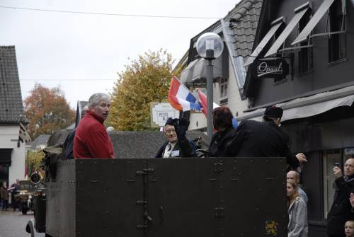 Arthur Rowledge, ex 5th battalion, Queens Own Cameron Highlanders, waves to the crowds from the back of a WW2 truck, 51st Highland Division veterans parade of honour, Vught, Holland, October 2009.